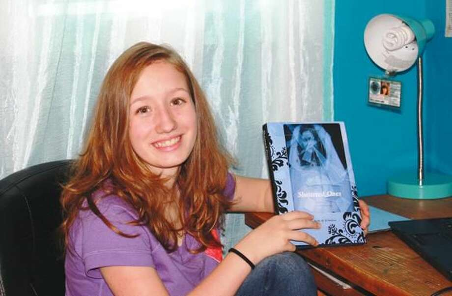 """Molly D'Andrea, 13, is always hard at work on her fiction writing. She recently published her first novel, """"Shattered Ones,"""" through Lulu Publishing. She plans to pursue a career as a writer."""