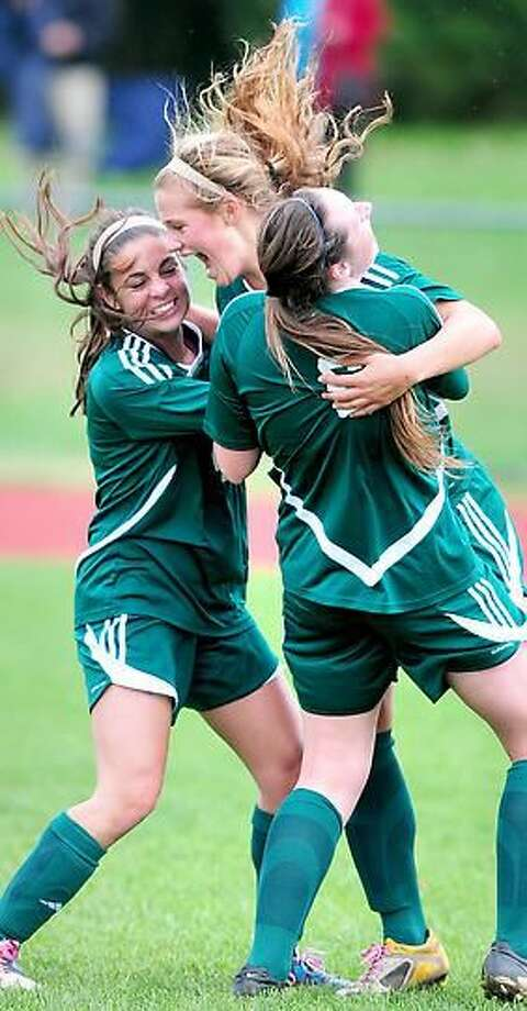 Rachel Ugolik (center) of Hamden is congratulated by teammates after scoring her first goal against Sacred Heart Academy in the first period on 10/15/2012.Photo by Arnold Gold/New Haven Register