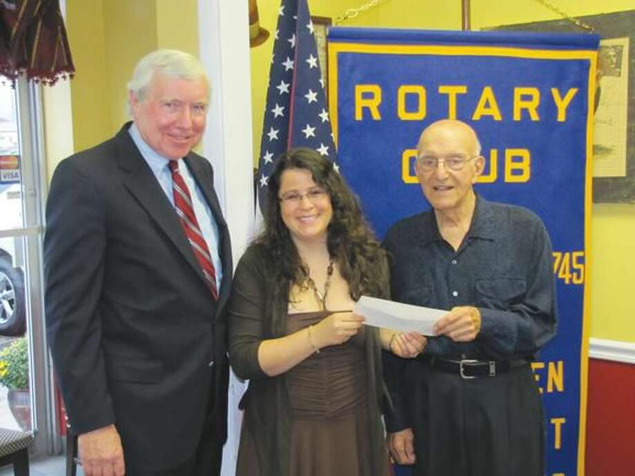 Photo courtesy of David Marchesseault, Rotary PR Chairman Angelo Verdini, right, a 50 year member of the North Haven Rotary Club, recently presented the club's donation to two executives from the St. Martin de Pores Academy, Jay Bowes and Allison Rivers.