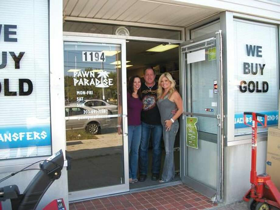 Photo by Lynn Fredricksen Tracy Hlavaty, Craig McCarthy and Krista Jacobs at the entrance to their Pawn Paradise shop where they buy, sell, trade, pawn, cash checks and provide bail bond services.