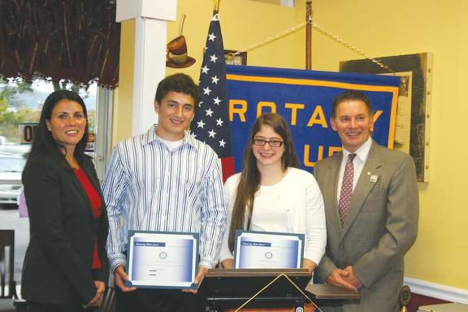 Submitted photo courtesy of Susan Pace & David Marchesseault, Rotary PR Committee Left to right, North Haven High School Assistant Principal Sandra Preneta, congratulates the fall Students of the Month, Eric Lofquist and Fallon McKeon, as does Rotary President Michael Hallahan.