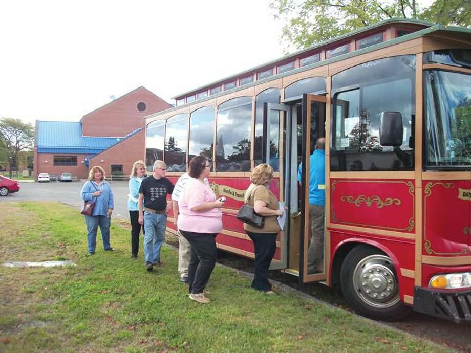 Photo by Lynn Fredricksen People line up to board a 1920s replica trolley for the North Haven Historical Society's annual trolley tour Sunday. Three tour groups departed from the Cultural Center at noon, 2 p.m. and 4 p.m. Once again, the event was a huge success and a complete sell out.