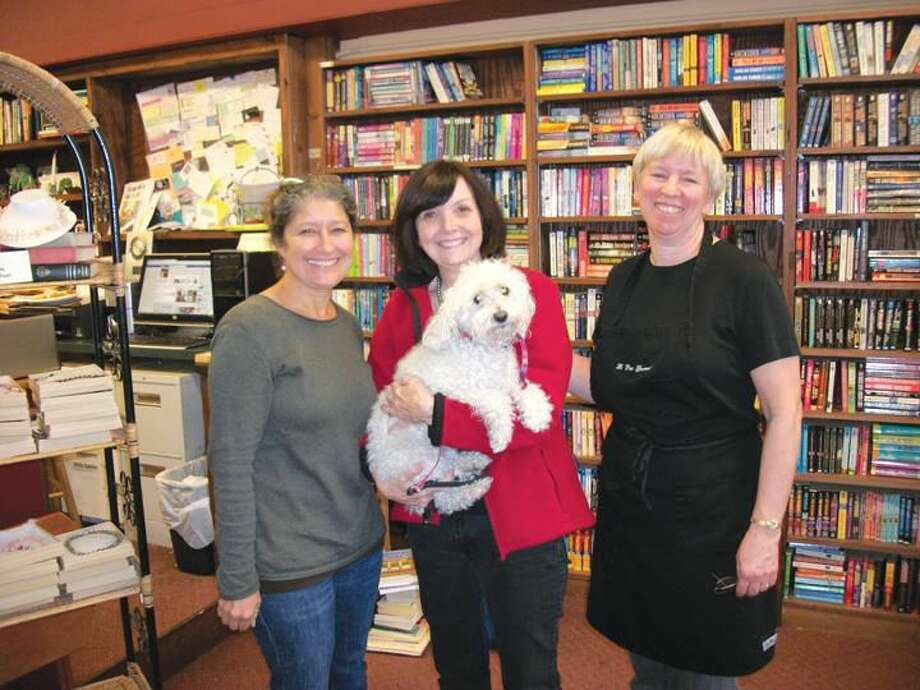 Left to right: Teresa Fields, Linda Mooser, Susan Gooley and Lily the mini-poodle are a winning team running three businesses - Legal Grounds, Books & Co., and La Petit Gourmet, respectively.