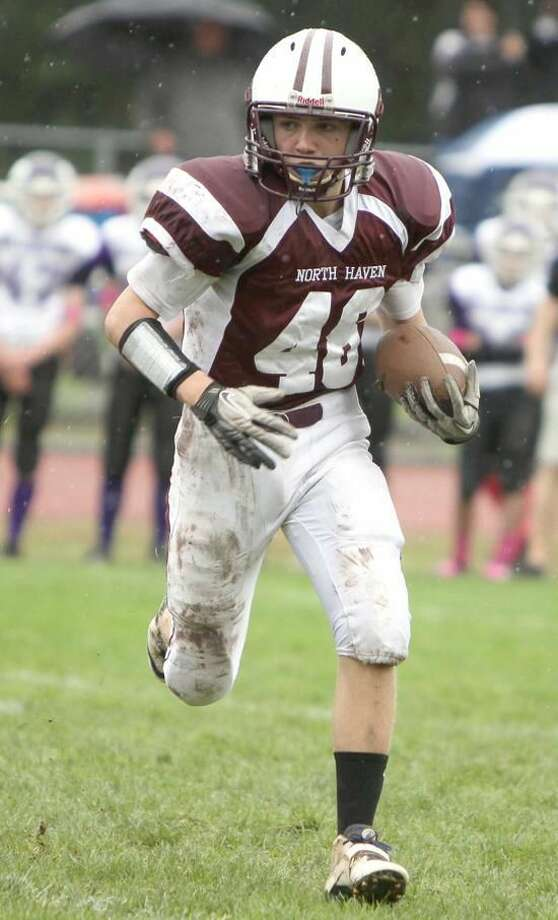 Photo courtesy of Gail Tantorski Max Sullivan runs with the ball for the North Haven eight-grade football team in Week 7 action. Sullivan had two fumble recoveries in the Indians' 22-0 victory over Wallingford.