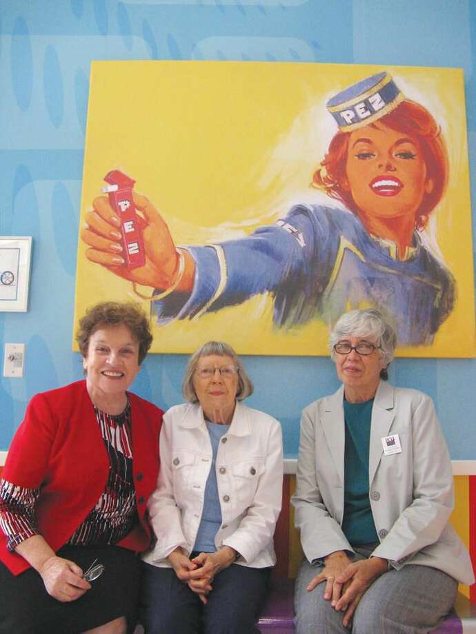 Submitted Photo Left to right: Hamden-North Haven League of Women Voters membership co-chair Elona Vaisnys and co-presidents Miriam Brody and Mary Bigelow are pictured at teh PEZ factory in Orange.