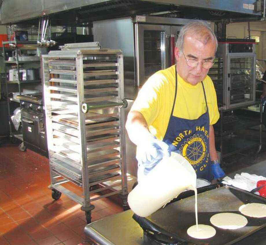 Photo courtesy of David Marchesseault, Rotary PR Chairman George Guertin, a Rotarian who also serves the community as an attorney, has become an expert on the grill.