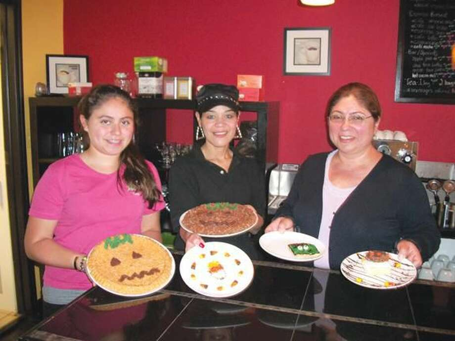 Photo by Lynn Fredricksen Diana Hart, 13, Lucy Fernandez and Ayda Hart show off some of the seasonal desserts they offer at Paola's Gourmet Specialties & Coffee at 1830 Dixwell Avenue, across from Home Depot. The restaurant is open five days a week and serves breakfast and lunch.