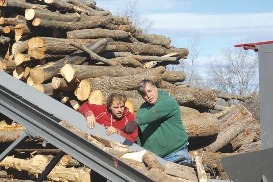 Photo by Marie Rella Phillip (left) and Paul Lavigne of Lavigne's Tree Service, Wallingford.