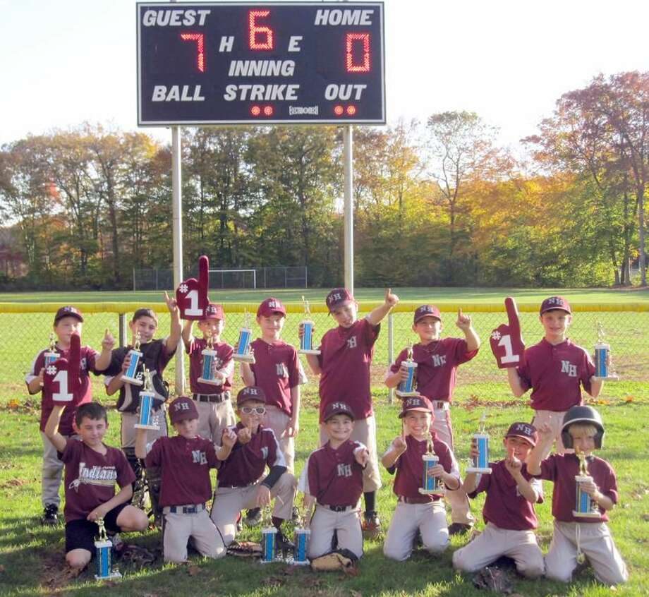 Submitted photo The North Haven Jr. Indians celebrate after winning the Central Connecticut Fall Ball League championship with a 7-0 victory over Wolcott in the finals.