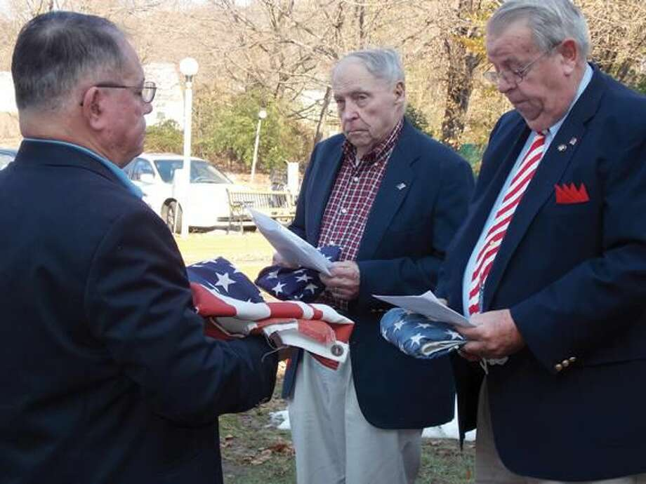 Submitetd Photo Lodge Secretary Andrew Caporossi, Hamden Lodge Past President Ed Gorman and Hamden Lodge Past President/Past President of CT Elks Association Phil Wilson honorable retire our service worn flags.