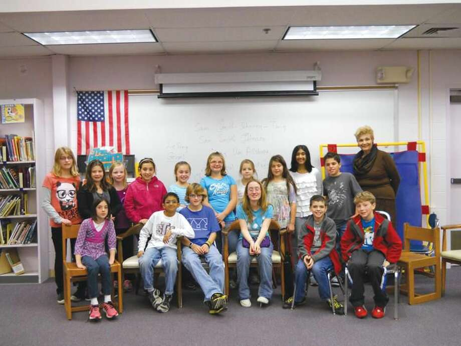Submitted Photo Molly D'Andrea (seated in the center) meets with Mrs. Lydia Westerberg (far right) and the children in the Young Writers' Club at Ridge Road School Elementary School in North Haven.