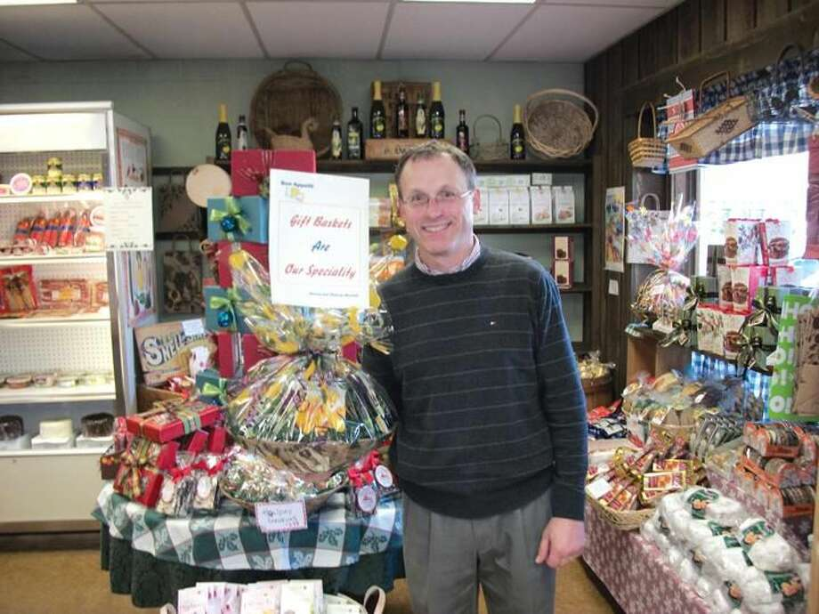 Photo by Lynn Fredricksen Roland Blakeslee displays one of many gift baskets for sale at his gourmet shop, Bon Appetit, at 2979 Whitney Avenue in the Mount Carmel section of Hamden. Blakeslee's shop is the go-to place for gourmet food, exotic cheeses and custom made gift baskets.
