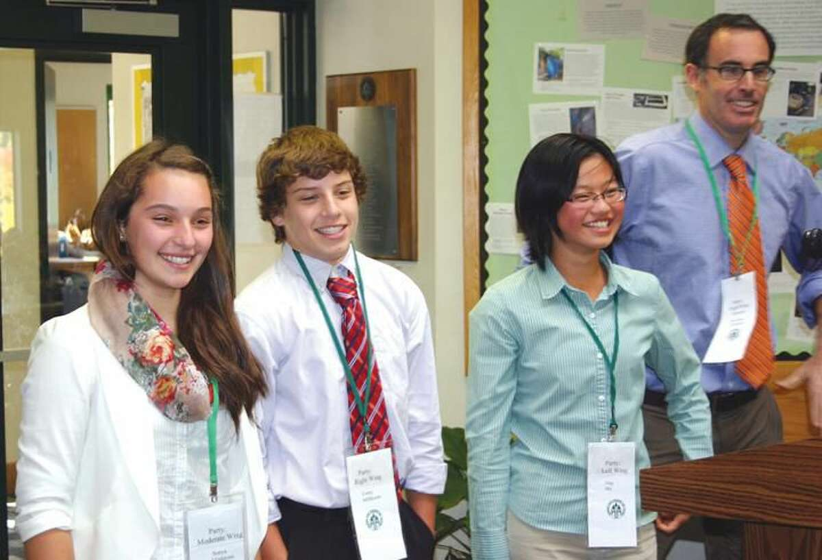 Submitted Photo Hamden Hall students Sonya Gladstone, Corey Millhouse and Jing Shi with Middle School Director Brian Christman.