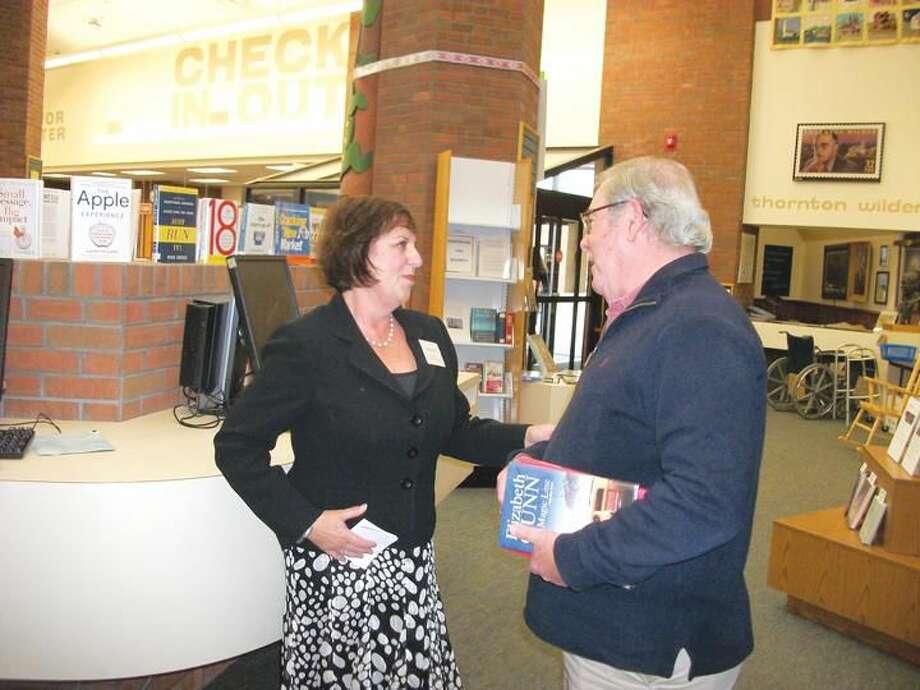 Photo by Lynn Fredricksen Hamden's new Library Director Marian Amodeo meets Al Gorman, who serves on Hamden's Legislative Council, at a recent reception held at Miller Library.