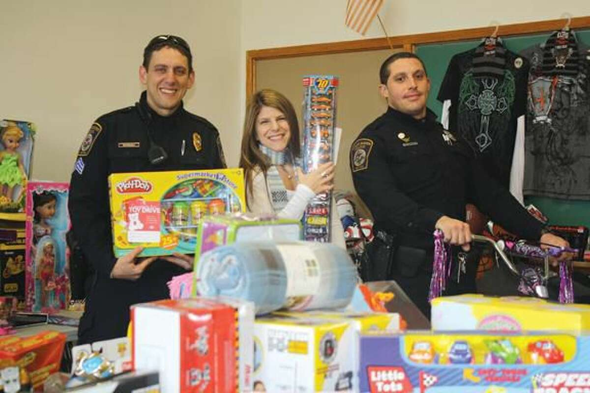 Submitted Photo Pictured from left to right are Sgt. Antonio De Pascale, Carla Riccio (Community Services), Ofc. Val Queiroga.