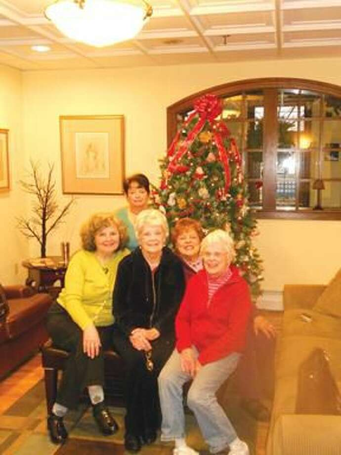 Submitted Photo Pictured are Emily Cosenza, Lynda O'Donnell, Barbara Flood, Amy Salvati and Mary Cameron by the decorated tree.