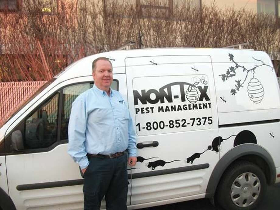 Photo by Lynn Fredricksen Bob Hannon, owner of Non-Tox Pest Management, stands by his truck decorated by one of his sons. Hannon, a long time staple in the business community, actively participates in community service and strives to give back to the community.