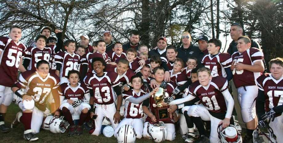 Submitted photo The North Haven fifth-grade team celebrates its Shoreline Youth Football Conference championship after beating Cheshire 24-7 in the title game.