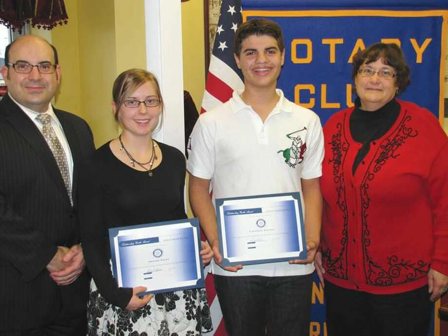 Submitted Photo North Haven High School Assistant Principal Andrew Pettola, left, congratulates Students of the Month Amanda Royka and Francesco Scarano, along with Rotary President Elect Debbie Volain.