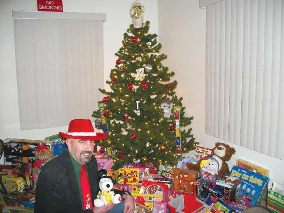 Photo by Lynn Fredricksen Dave Signore, a member of the Connecticut Valley Litho Club, checks out some of the toy donations as part of a toy drive the CVLC conducted in partnership with the Knights of Columbus. All the donations will benefit local children through the Department of Community Services.