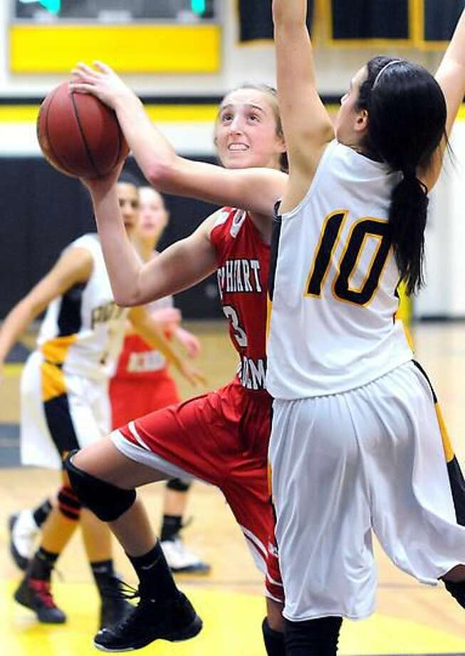 Lexi Iannone (left) of Sacred Heart shoots past Marie Papazian (right) of Amity in the first half on 12/5/2012.Photo by Arnold Gold/New Haven Register