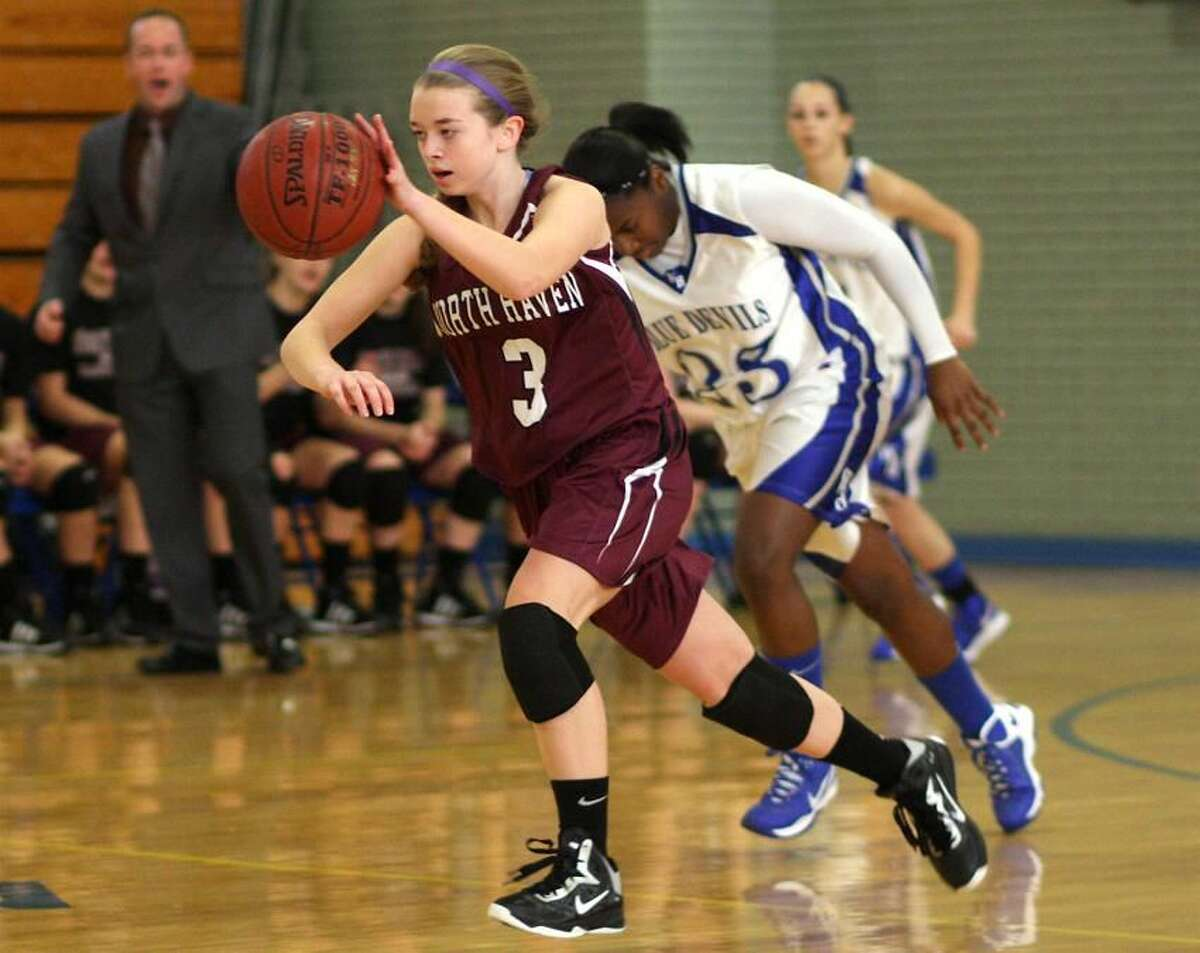 Photo by Russ McCreven North Haven's Jill Johnson pushes the ball upcourt against West Haven.