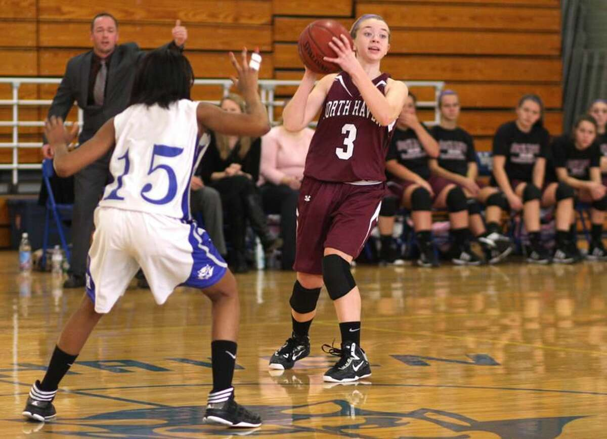 Photo by Russ McCreven North Haven's Jill Johnson looks for an open teammate.
