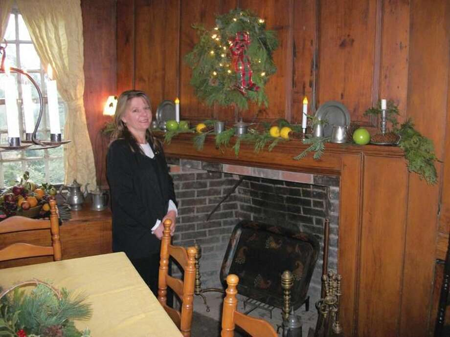 Photo by Lynn Fredricksen Janet Greenlaw, leader of the North Haven branch of Prudential Realty, admires the seasonal decorations at Rising Sun Tavern that were done by her colleagues Joan Clinton and Joan Tudor. Area realtors teamed with homeowners in North Haven and Wallingford to decorate their houses for the Quinnipiac Chamber of Commerce Holiday House Tour Dec. 1. The event was a fundraiser for the Chamber's scholarship program.