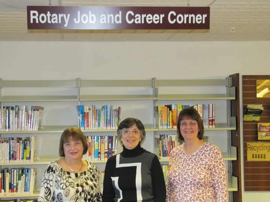 Photo by David Marchesseault & George Guertin, Rotary PR Committee Lois Baldini, the Director of the North Haven Library (left), joined by the Assistant Director, Patricia Dortenzio (center), and the Reference Librarian, Nancy Haag (right), welcomed the Rotary Club.