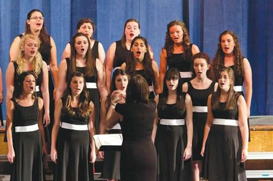 Submitted Photo North Haven High School's Key of She vocal ensemble performs at a recent concert.