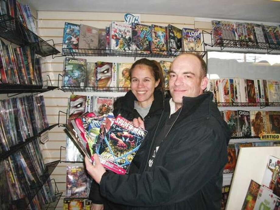 By Lynn Fredricksen Rob Cavallaro and Kari McMahon, both of Hamden, shop regularly at DJ's Comics & Cards in North Haven. They discovered the store while looking for comic books for McMahon's 6-year-old son.