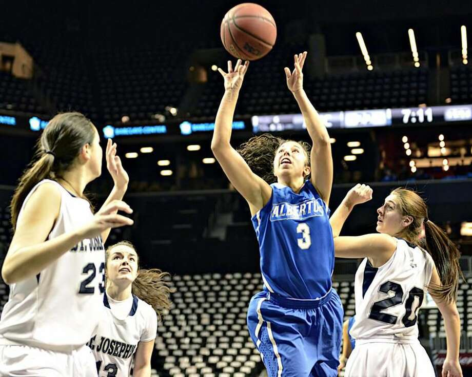Photo by Ron Waite/ Albertus Magnus Athletics Albertus Magnus junior Lianna Carrero, of Hamden, shoots against St. Joseph's last week at the Barclays Center in Brooklyn. She was named the ECAC Division III New England Player of the Week.