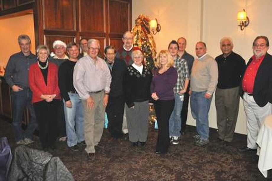 Submitted Photo Bellini's Restaurant was the setting Dec. 19 for the North Haven Camera Club to combine their holiday party and first anniversary. North Haven resident Rich Ziemba formed the club in December 2011.