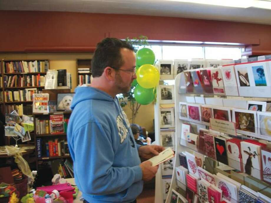 Photo by Lynn Fredricksen Hamden resident Mark Lawless shops the vast card selection at Books & Co. on Saturday. The popular spot was chosen as a Cash Mob location after a nomination process through the town's Economic Development Corporation.