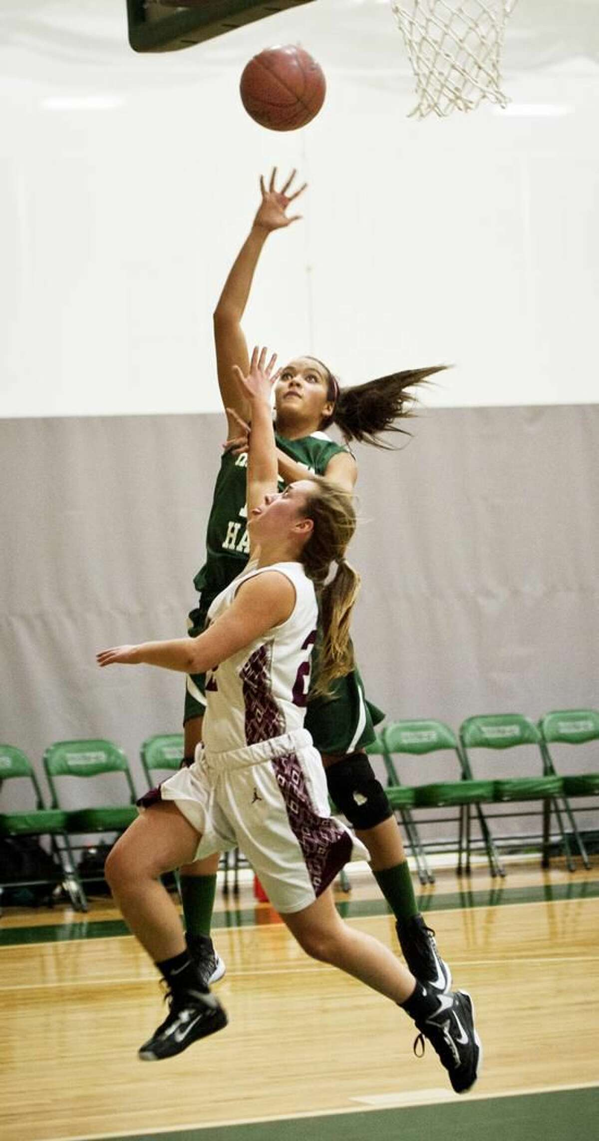 Hopkins' Emma Banks can't catch Hamden Hall's Krystina Reynolds on her way to the basket during the second half Tuesday. Melanie Stengel/Register
