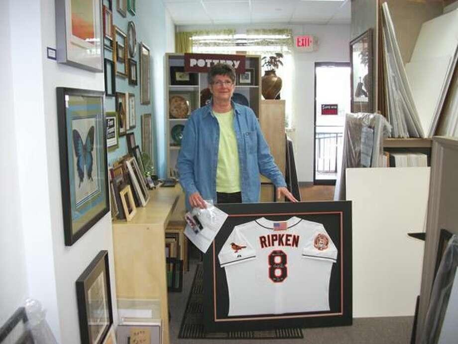 Photo by Lynn Fredricksen Liz Hellwig, of Hamden, displays a work in progress at her frame shop, Framed, at 1224 Whitney Ave.