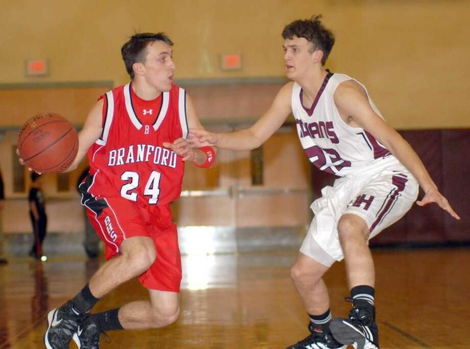 Photo by Dave Phillips North Haven's Chandler Andrewson defends Branford's Alex King during the Indians' 46-41 victory last Friday night.