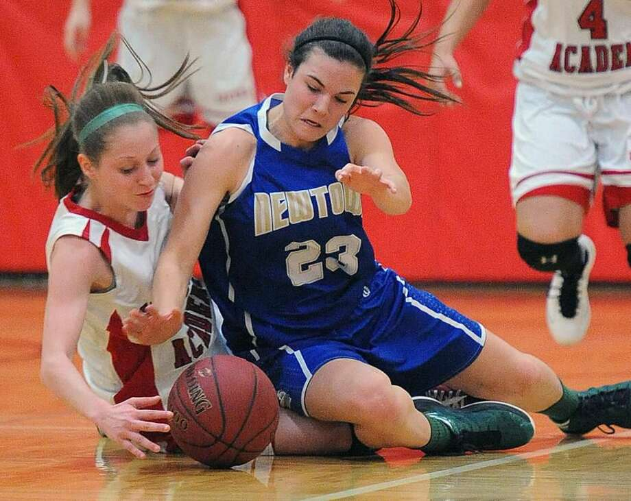 Hamden— Newtown's Bridget Power and Sacred Heart Academy's Shylia Osmond battle for a loose ball during the 4th quarter. Photo-Peter Casolino 02/26/12