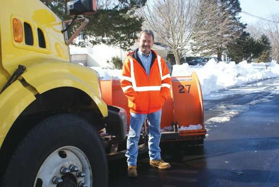Photo by Marie Rella John Dugay, Heavy Equipment Operator for the Town of Hamden, has been driving the same plow route (one of 15 routes in Hamden) for 11 years.