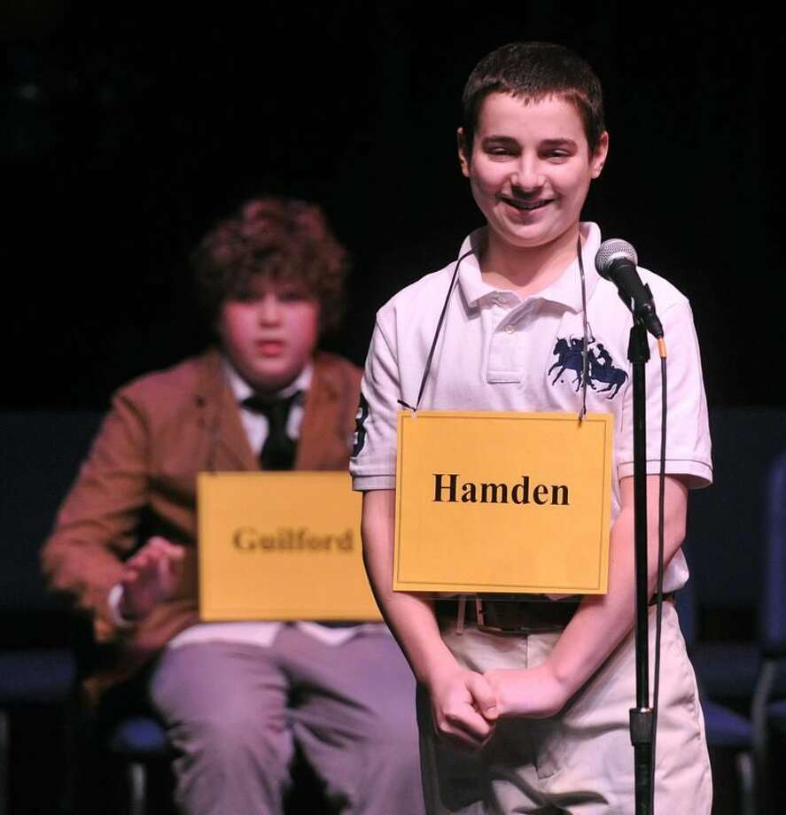New Haven— Anthony Capasso, 13, from Hamden Hall, smiles as he wins the New Haven Register Spelling Bee at SCSU's Lyman Hall. Behind him is Max Martin, 14, of E.C. Adams Middle School in Guilford, who came in 2nd place. Photo-Peter Casolino/Register