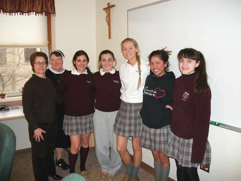 Photo by Lynn Fredricksen Chaperones Sue Nelson (left) and Sister LanyJo Smith traveled to Camden, N.J. with 10 students from Sacred Heart Academy to do mission work in the nation's poorest city. Pictured with them are, (left to right) Sienna DeMaio, Sabrina Schiano, Rachael Casasanta, Vanessa Passaretti and Isabella Siegel, who made the trip during their February vacation.