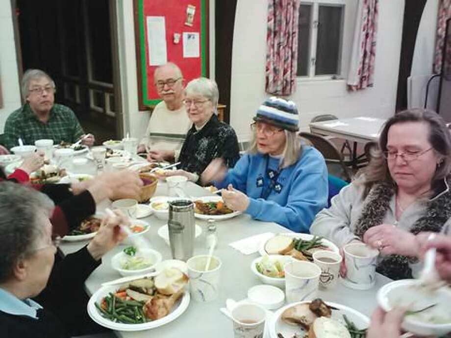 Submitted photo by Michael Hallahan John and Nancy Graef (top center) have assisted with the community suppers at St. John's Church for many years.
