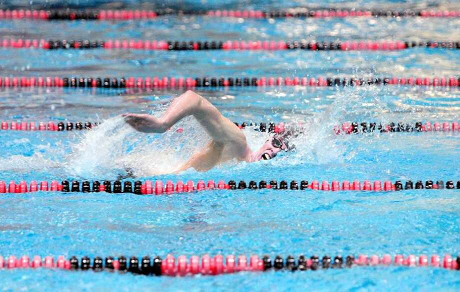 Connor Robison of Sheehan is ahead of the pack as he swims to a first place finish in the 500 yard freestyle at CIAC Boys Class S Championships at Wesleyan University in Middletown on 3/13/2013.Photo by Arnold Gold/New Haven Register