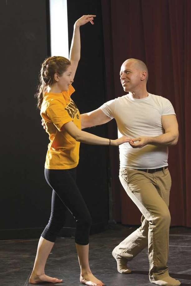 Submitted Photo William Jellison, of Hamden, right, associate professor of psychology at Quinnipiac University, and his dance partner Jaclyn Plante, of North Scituate, R.I., rehearse for 'QU Dancing with the Stars,' which will take place at 7:15 p.m. on Friday, April 12 on Burt Kahn Court on the Mount Carmel Campus at Quinnipiac. Proceeds from the event will benefit Camp Sunshine, an organization that provides a camp for children with serious illnesses and their families.