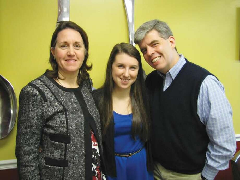 Submitted Photo January Student of the Month Caitlin Barrett, center, is pictured with her parents, Nancy and Sean Barrett.