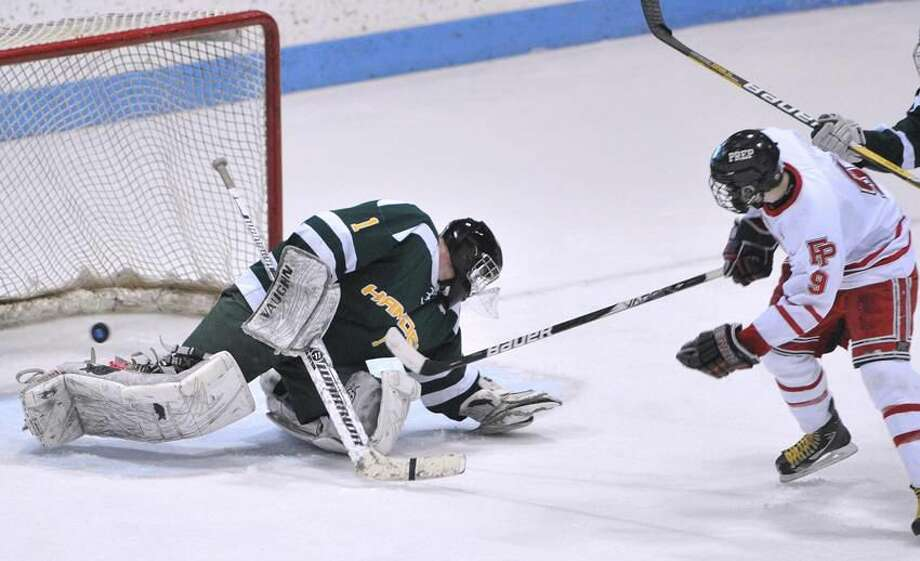 New Haven— Fairfield Prep's Nick Bargiello gets one past Hamden goalie Matt Hoff during the second period. Photo-Peter Casolino