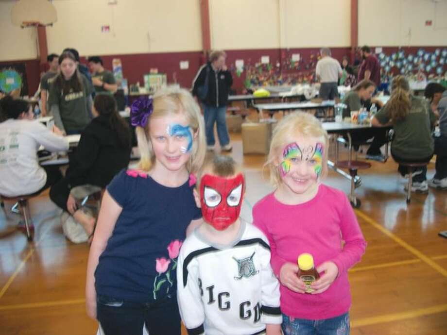 Photo by Lynn Fredricksen For the Wilson family, of North Haven, the annual Earth Day celebration was a real family affair. Natalie, 8, Richie, 4, and Alison, 6, particularly enjoyed having their faces painted.