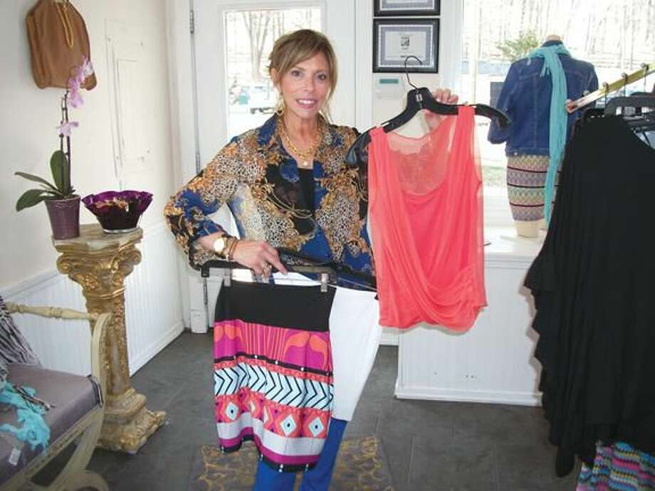 Photo By Lynn Fredricksen Meryl Henrici displays some of the fashions available at her boutique, Flirt. New spring merchandise is arriving daily. Check it out at 3551 Whitney Avenue.