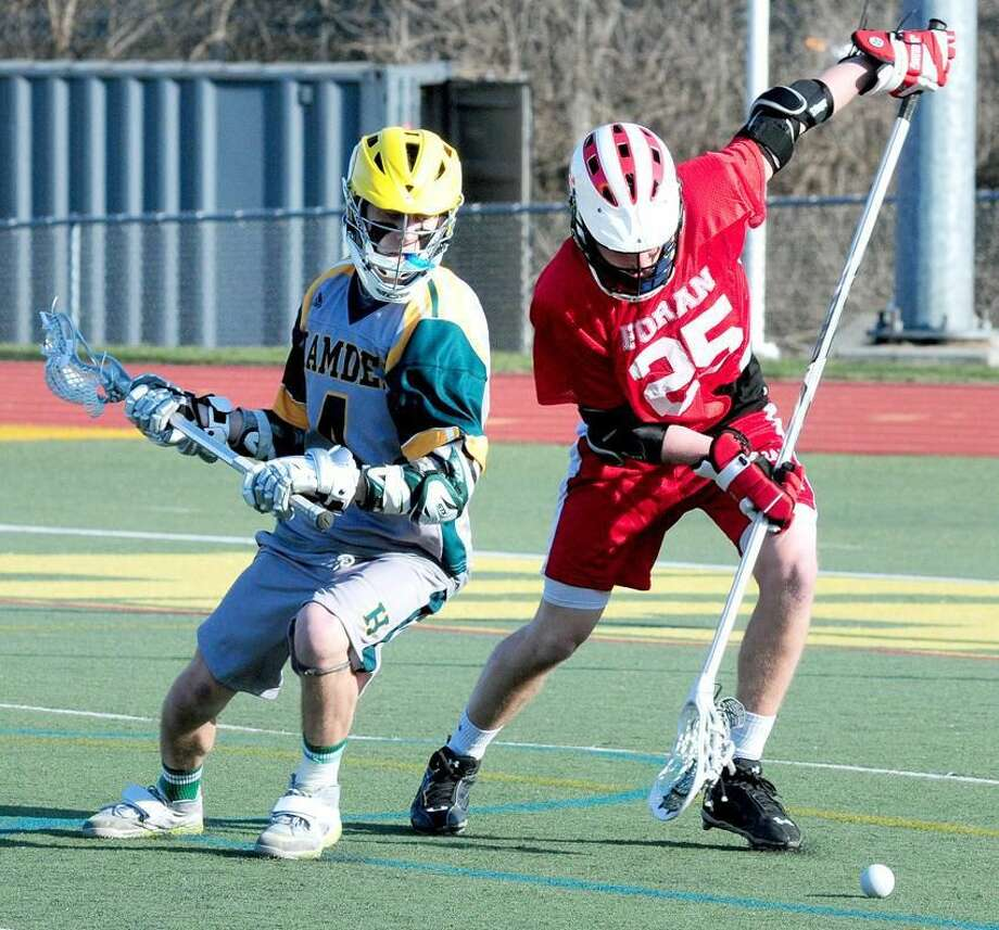 Nick Tafuto (left) of Hamden and Anthony Kopatch (right) of Foran fight for the ball on Friday. Photo by Arnold Gold/New Haven Register