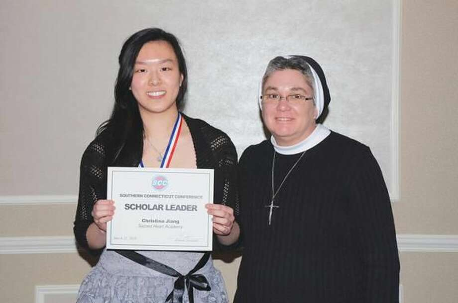 Submitted photo by Bill O'Brien Sacred Heart Academy student Christina Jiang is pictured with principal Sister Maureen Flynn ASCJ. Tess Cersonsky was unable to attend the banquet.